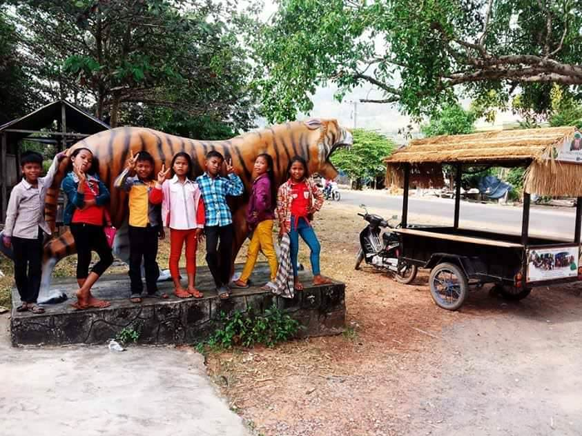 """Tuk-Tuk Taco Stand and school kids"". Photo by Tracy Stettler"