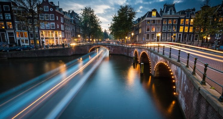 time lapse over a canal in Amsterdam at night