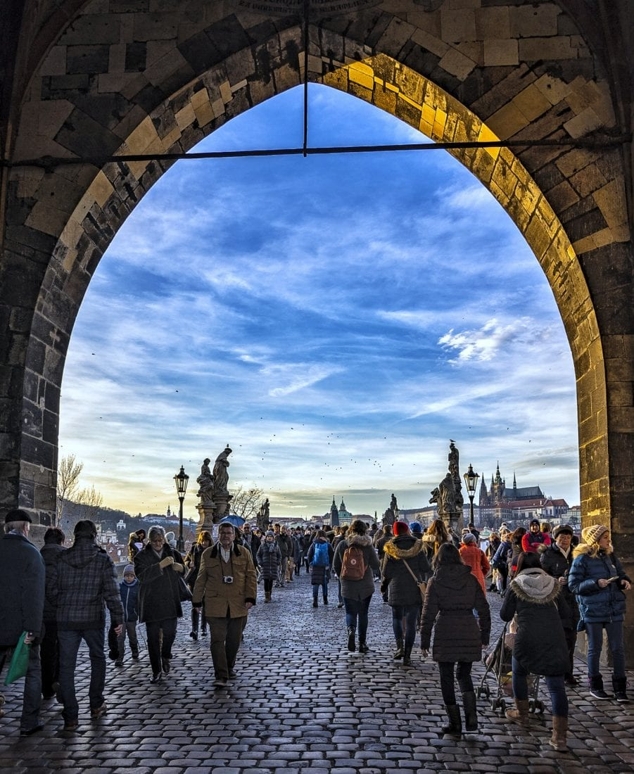 things to do in Prage - walking across the Charles bridge in Prague