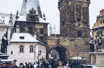 snow on the charles bridge in prague
