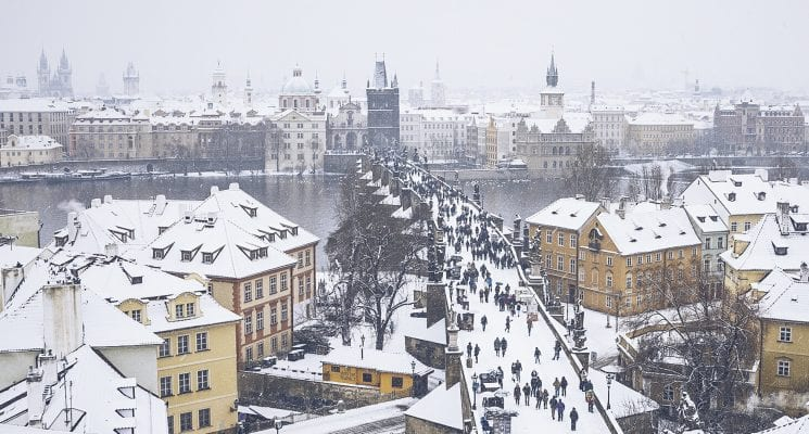 snow on the charles bridge in prague