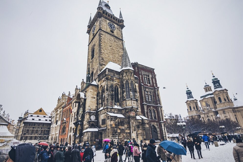 Snow in prague's Old Town Square, Astronomical clock in Prague