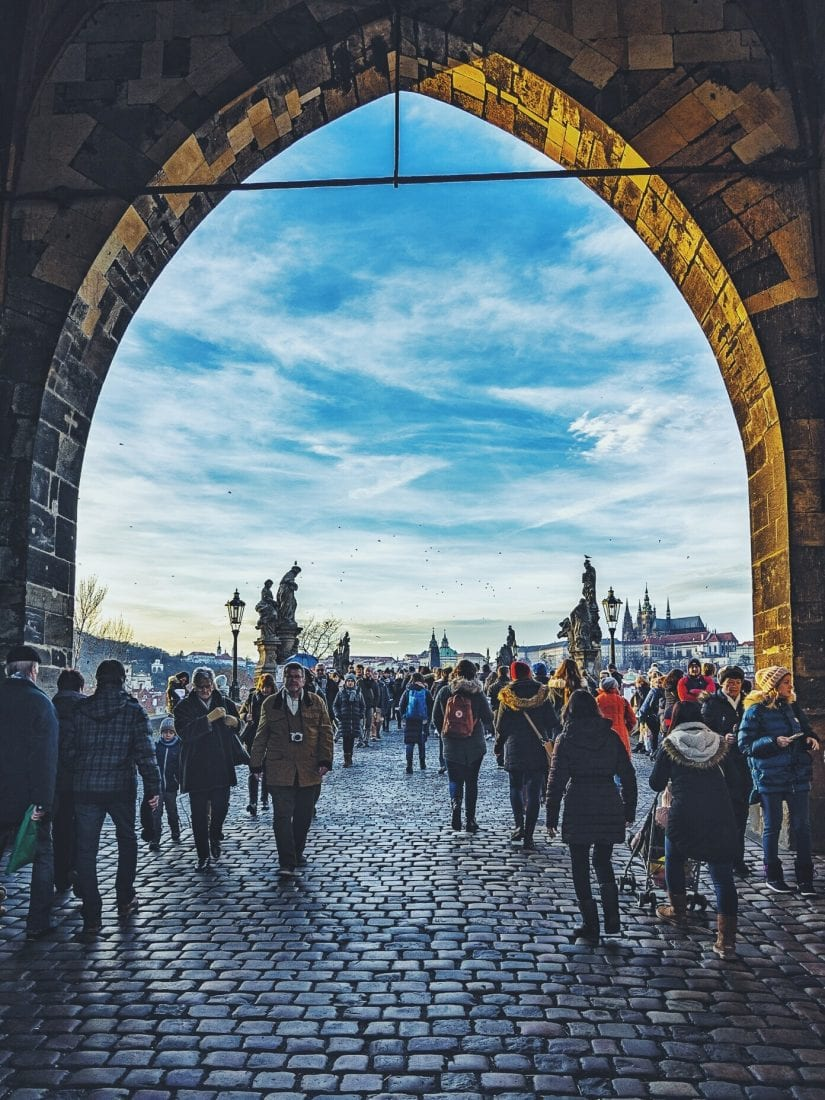 walking the charles bridge in prague