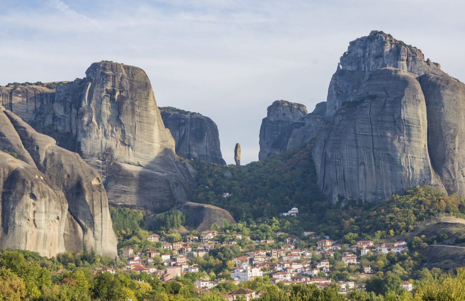 meteora rises up above the village of kastraki