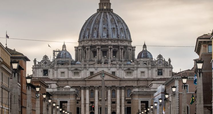 View of a man walking in front of the Vatican in Rome