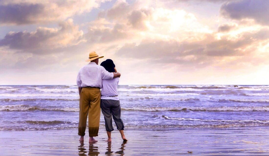 a couple standing looking at galveston beach