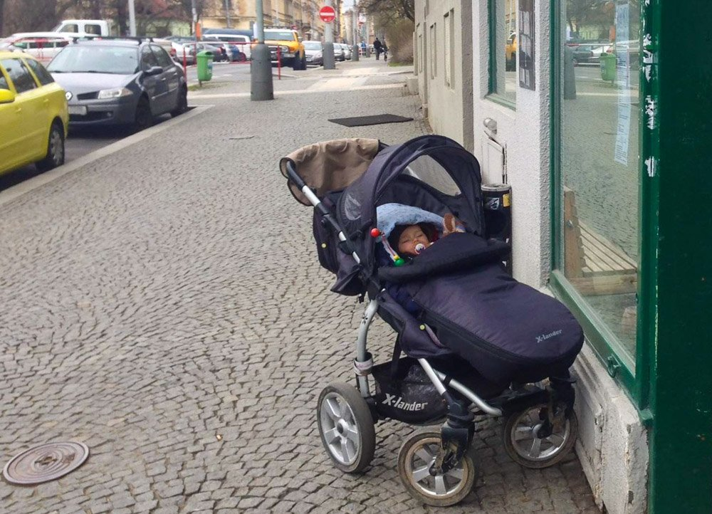 living in prague baby stroller alone outside