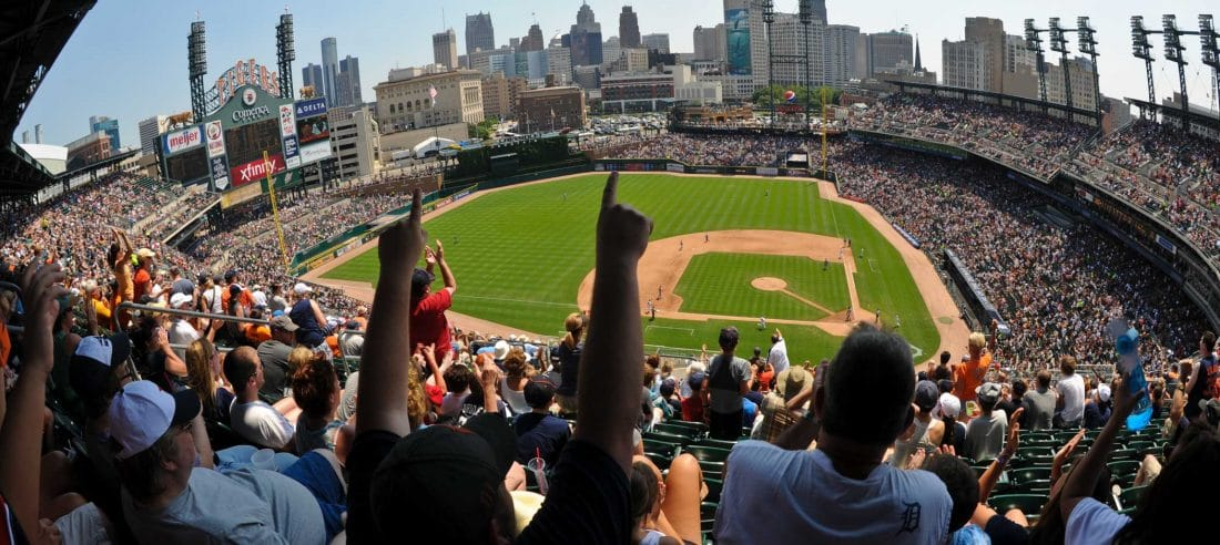 people celebrating a baseball game in tigers detroit stadium