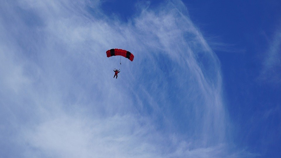 a parachute of a skydiver against a blue sky