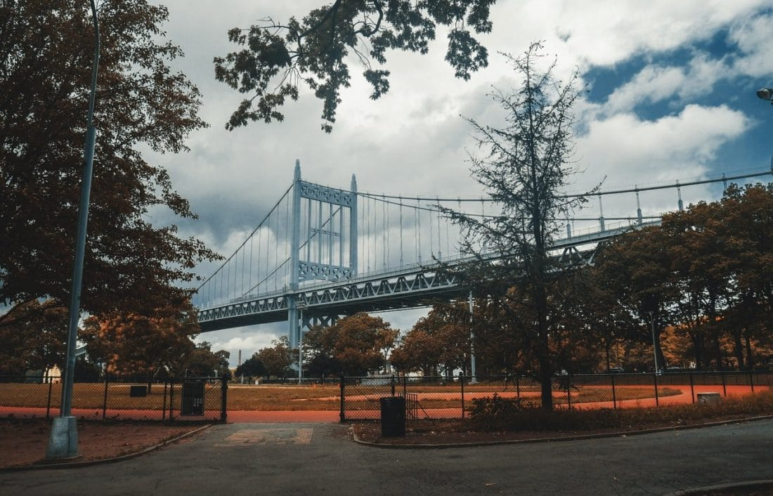 view of the Triborough bridge above Astoria Park in NYC