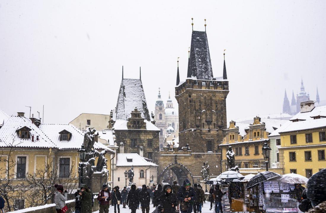 snow falls on the Charles Bridge in Prague