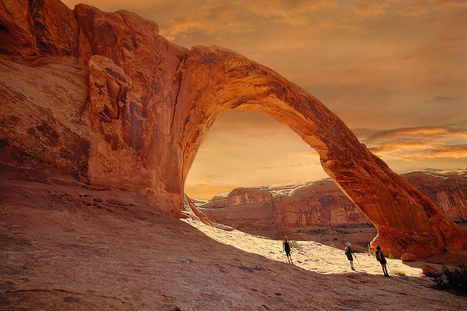 the sandstone corona arch near moab during golden hour