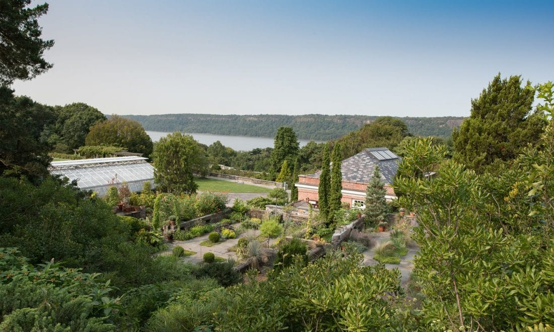 view of the Hudson and a garden at Wave Hill Park in the Bronx, NYC