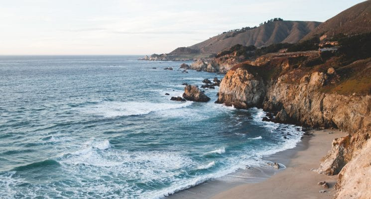 waves lapping against the coastline in Big Sur, California