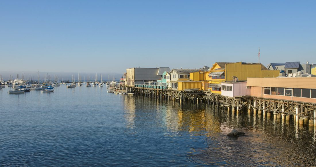 A view of Monterey's Fisherman's Wharf during golden hour.