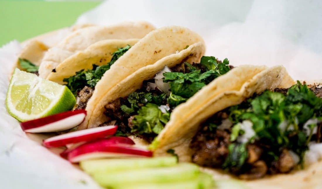 a plate of three delicious tacos on display