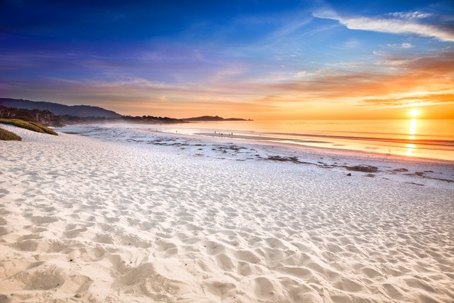 the white sands of Carmel beach at sunset