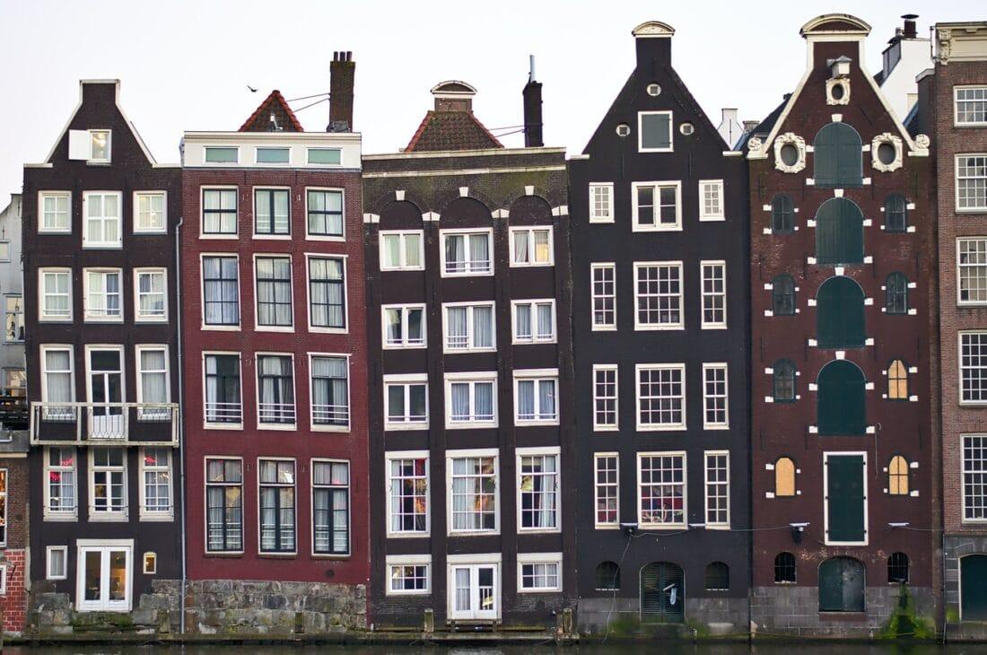 buildings standing side by side in Amsterdam