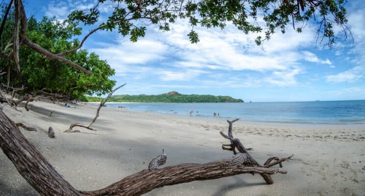 picture of a beach in costa rica on a partly cloudy day