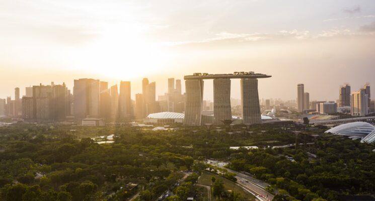 sun rising over the Singapore skyline