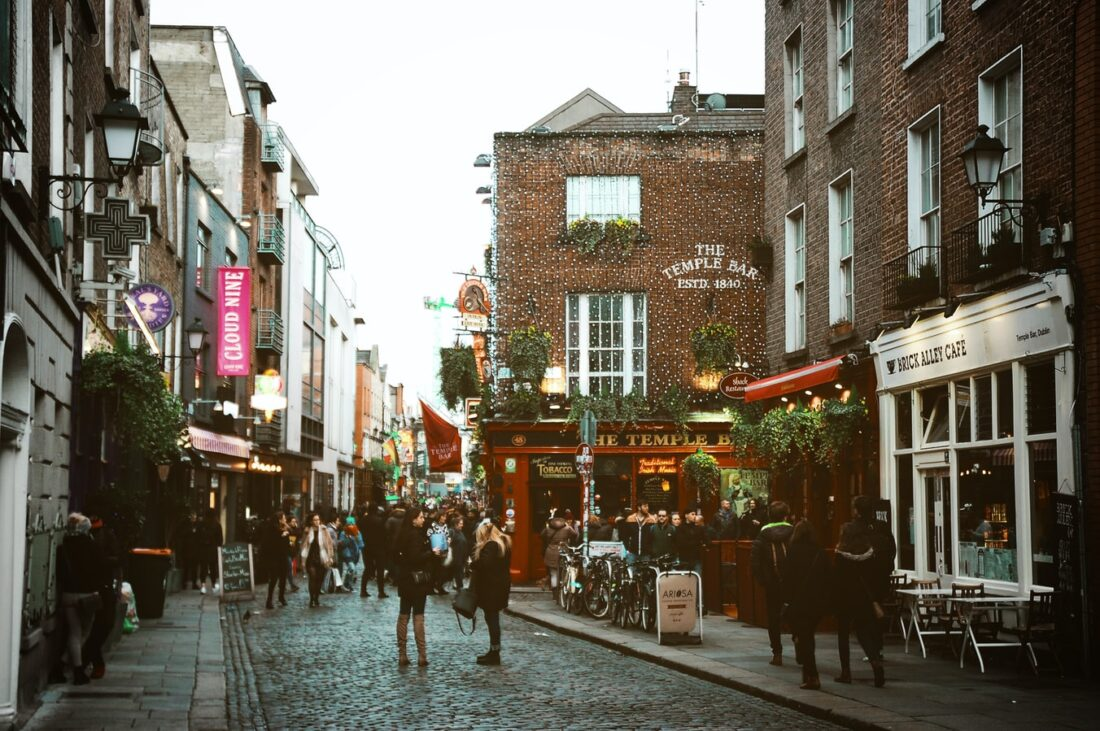 people on a street in dublin, ireland