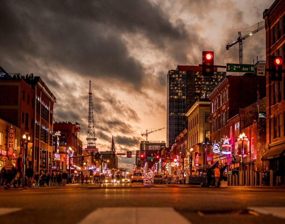 a picture of a street in Nashville at dusk
