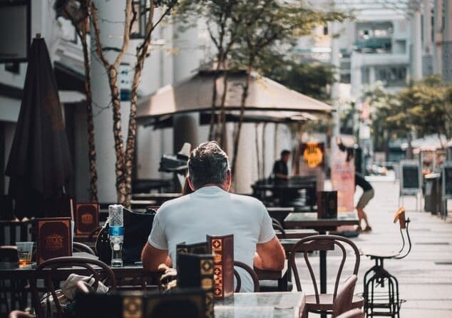man sitting with back to camera at cafe in Singapore