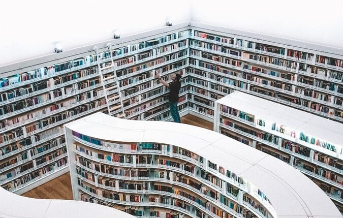 man looking at books in Singapore library