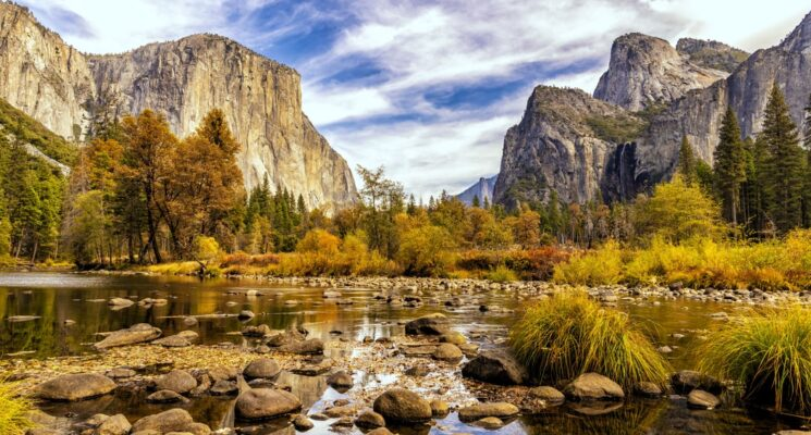 a creek and mountains in Yosemite National Park