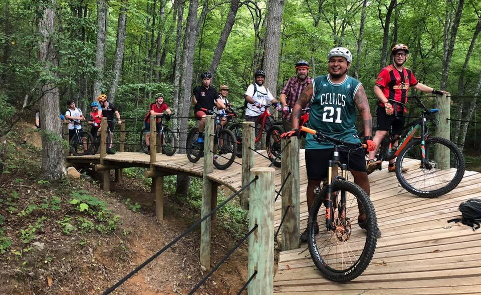 people on mountain bikes on a trail